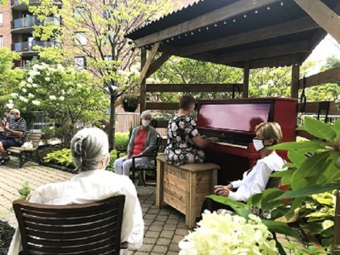 Residents of Cogir Retirement Home's Domaine des Forges 1 and 3 in Laval Are Delighted With Their Red Piano